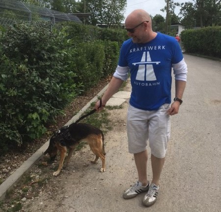 Senior Director Georg Herrnleben helped clean kennels at an animal shelter